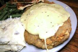 Chicken-fried steak comes with mashed potatoes, gravy, green beans and Texas toast at Good Time Charlie's.