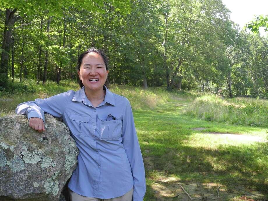 Jennifer Salkin leads forest bathing walks at Weir Farm National Historic Site in Wilton on July 26. Photo: Jeannette Ross / Hearst Connecticut Media / Wilton Bulletin