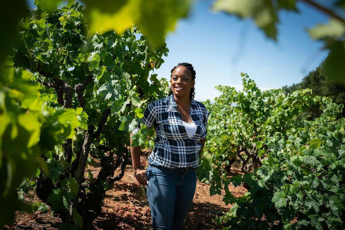 Brenae Royal, 29, poses for a photo near the oldest Cabernet Sauvignon vines at Monte Rosso Vineyard in Sonoma, Calif., on Thursday, July 25, 2019.