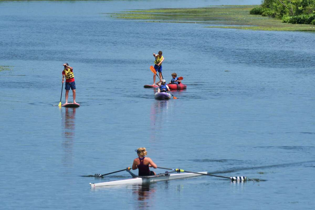 Paddlers and a rower make their way down Fish Creek on Thursday, August 1, 2019, in Saratoga Springs, N.Y. (Paul Buckowski/Times Union)