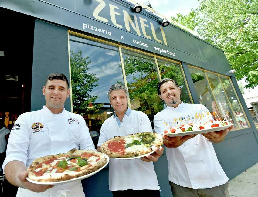 New Haven, Connecticut - Thursday, August 1, 2019: Co-owners and brothers, left to right, Gazmir Zenelli, left, Aleko Zeneli, and Jeshar Zeneli, officially open Zeneli's Pizzeria & Cucina Napoletana on Wooster Street in New Haven Thursday. The restaurant fare offers New York City award winning pizza and pasta among other menu items. The Zaneli brothers immigrated from Albania, to Italy, then Brooklyn and have followed their dreams by landing on New Haven's Wooster Street, arguably the pizza capital of the world.