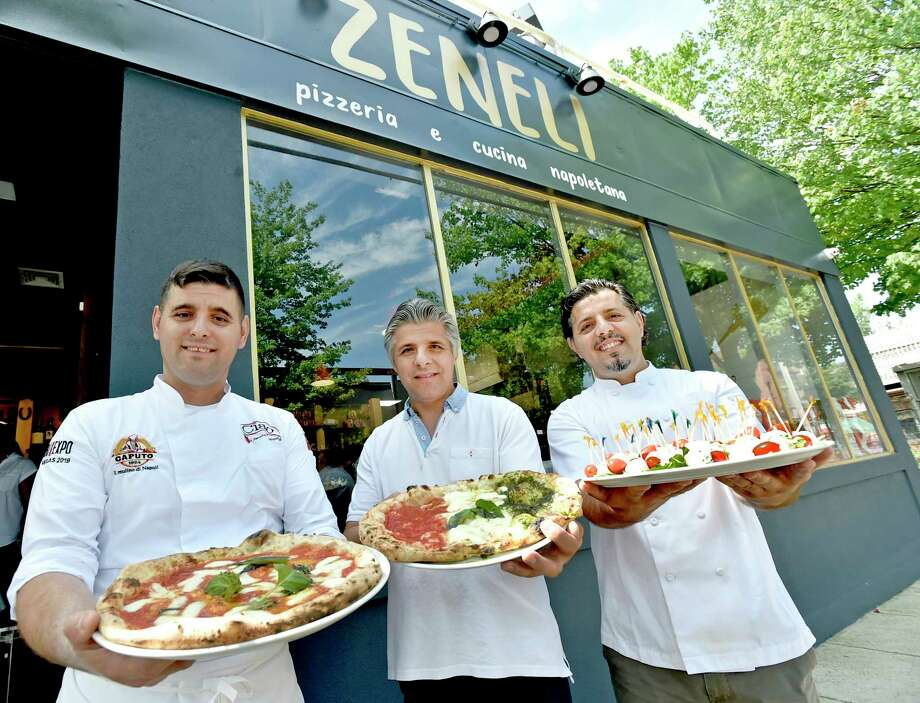 New Haven, Connecticut - Thursday, August 1, 2019: Co-owners and brothers, left to right,  Gazmir Zenelli, left, Aleko Zeneli,  and Jeshar Zeneli, officially open Zeneli's Pizzeria & Cucina Napoletana on Wooster Street in New Haven Thursday. The restaurant fare offers New York City award winning pizza and pasta among other menu items. The Zaneli brothers immigrated from Albania, to Italy, then Brooklyn and  have followed their dreams by landing on New Haven's Wooster Street, arguably the pizza capital of the world. Photo: Peter Hvizdak, Hearst Connecticut Media / New Haven Register