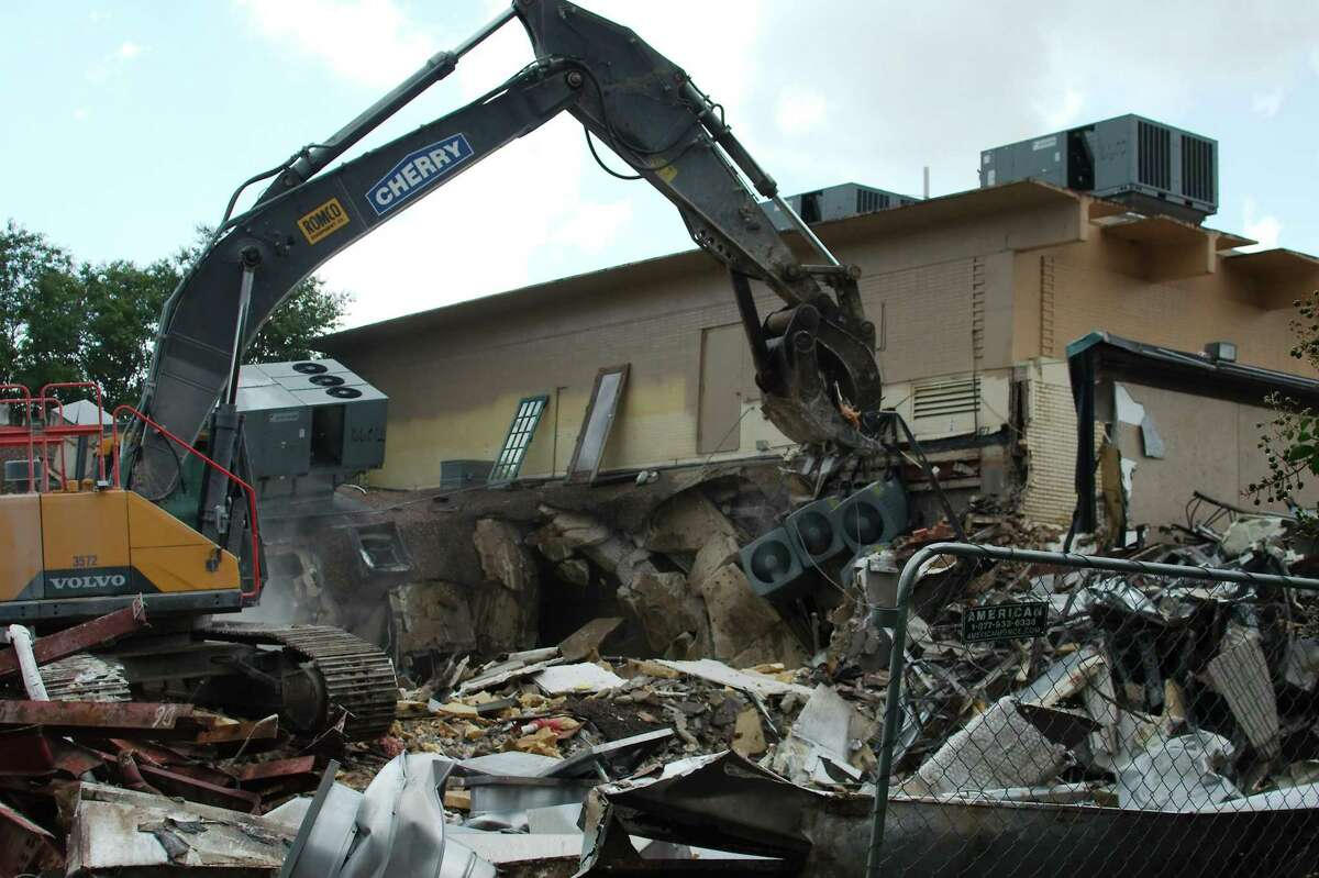 An excavator rips off portions of the building that once housed the Clear Lake Theatre, which opened in 1966.