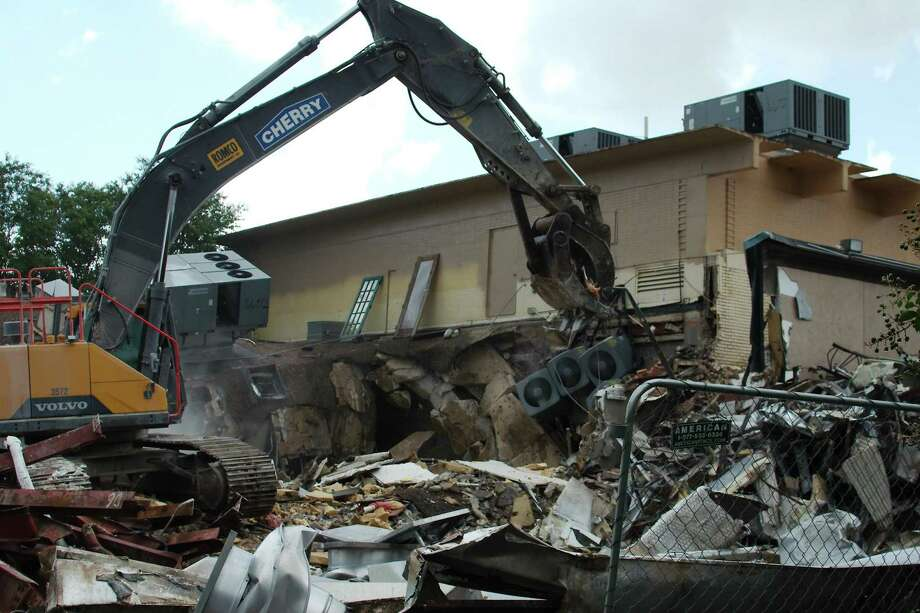 An excavator rips off portions of the building that once housed the Clear Lake Theatre, which opened in 1966. Photo: Kirk Sides / Staff Photographer / © 2019 Kirk Sides / Houston Chronicle
