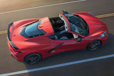 """A hallmark of the Corvette has been its removable roof. The 6.2-liter small-block Chevy can be seen under its own 3.2mm hatch panel. We'd like to see a zero-cost """"Stingray badge-delete"""" option."""