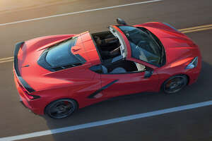 "A hallmark of the Corvette has been its removable roof. The 6.2-liter small-block Chevy can be seen under its own 3.2mm hatch panel. We'd like to see a zero-cost ""Stingray badge-delete"" option."