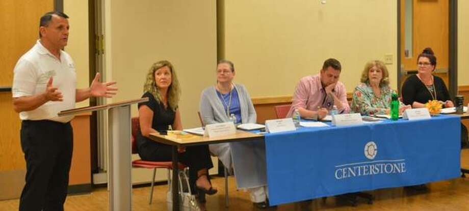 Centerstone CEO John Markley, far left, addresses July Spotlight Series panelists Laura Ballard, A.J. French, Ty Bechel, Jan Green and Brittany at the July 30 event.