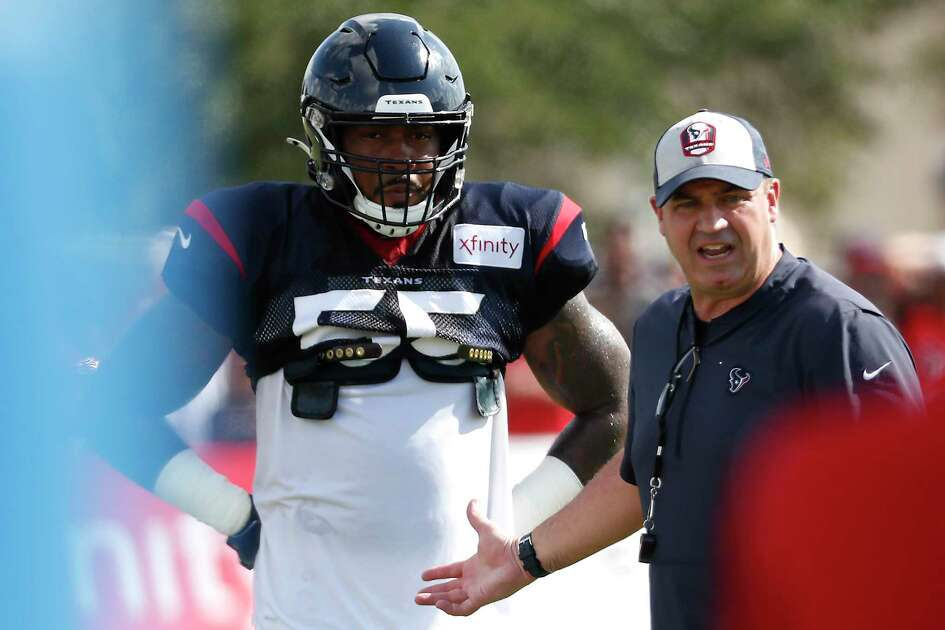 Houston Texans head coach Bill O'Brien works with inside linebacker Benardrick McKinney (55) during training camp at the Methodist Training Center on Thursday, Aug. 1, 2019, in Houston.