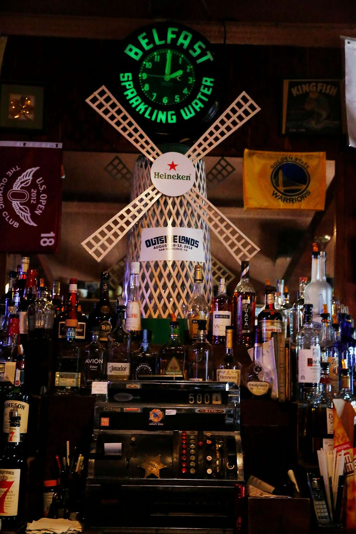 An original cash register and clock are seen at Portals Tavern on Wednesday, July 31, 2019 in San Francisco, Calif.
