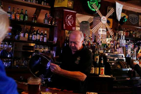 Don Gorwky, owner, pours ice from a bucket while working at Portals Tavern on Wednesday, July 31, 2019  in San Francisco, Calif.