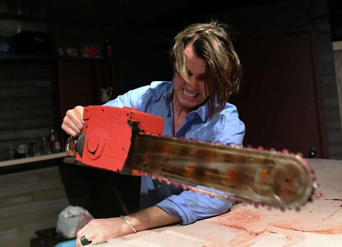 """Ash, played by Jonathan Pennington, cuts off his possessed hand in """"The Evil Dead."""""""
