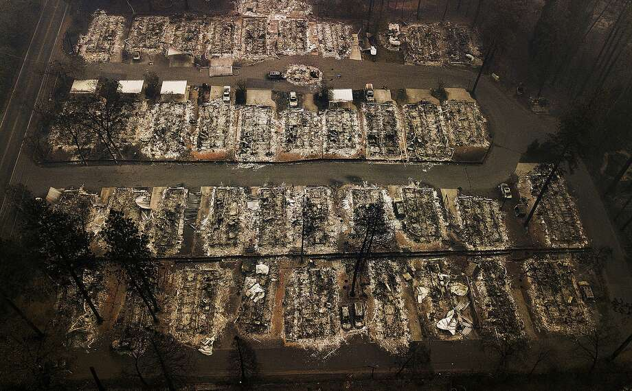 Residences leveled by the Camp Fire in Paradise (Butte County) in 2018. Some rural areas with high fire risk are seeing a rise in insurers dropping customers. Photo: Noah Berger / Associated Press 2018