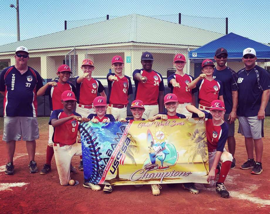 Fury Fire, a 12U baseball team based in Conroe, won the United States Specialty Sports Association (USSSA) Global World Series in Gulf Shores, Alabama on July 26, 2019. Fury Fire won three games on July 26 en route to the title, beating teams from Louisiana, Texas and Arkansas on the way. Pictured, back row, left to right: coach Clint Johnson, Tai Nguyen, Logan Harvey, Ryan Norlander, DJ Woods, Owen Vetter, Lincoln Payne, coach Jacob Harvey and coach Grant Almquist; front row, left to right: Gavin Edwards, Tanner Johnson, Ryan Kabbara, Gavin Almquist and Caden Jordan. Photo: Submitted / Submitted
