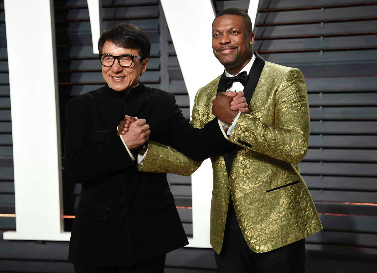 Jackie Chan and Chris Tucker arrive at the Vanity Fair Oscar Party in 2017.