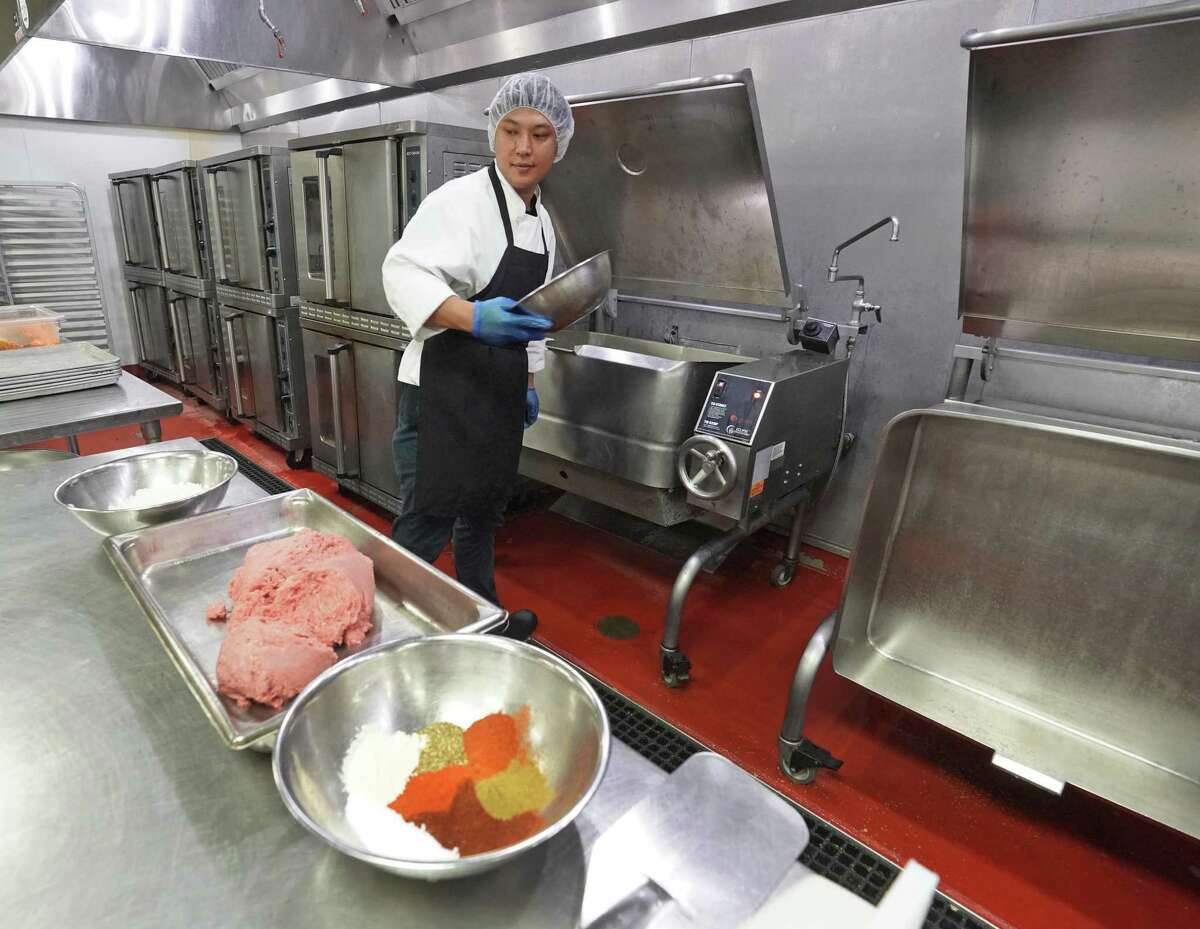 Employees prepare food at the Snap Kitchen commercial kitchen in Fort Worth, Texas on Tuesday, July 23, 2019. The Austin-based company recently announced plans to expand its home delivery of its prepared meals to 15 states nationwide.