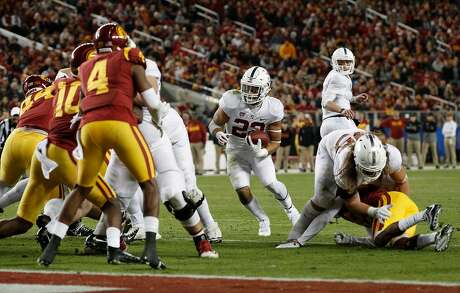 Stanford's Cameron Scarlett, 22 looks for a hole but comes up short in the first half, as the Stanford Cardinal takes on the USC Trojans in the PAC-12 championship game at Levi's Stadium, in Santa Clara Calif. on Fri. December 1, 2017.