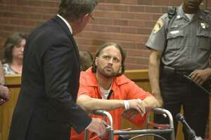 Aaron Bouffard, right, of Bristol, with John Walkley from the Public Defenders Office, was arraigned in Danbury Superior Court on Wednesday in connection to a knife-wielding incident on July 3rd. Bouffard was shot by Danbury Police officer Alex Relyea following a two-hour manhunt. July 10, 2019, in Danbury, Conn.