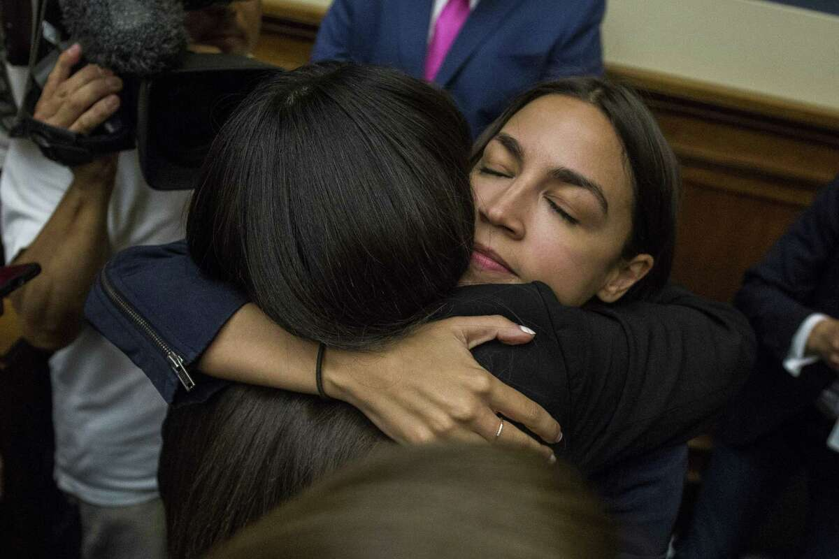 WASHINGTON, DC - JULY 10: Rep. Alexandria Ocasio-Cortez (D-NY) hugs Yazmin Juarez, whose 19-month-old daughter Mariee died after detention by ICE, following a House Oversight and Reform subcommittee on Civil Rights and Civil Liberties hearing discussing migrant detention centers' treatment of children on Capitol Hill on July 10, 2019 in Washington, DC. (Photo by Zach Gibson/Getty Images)