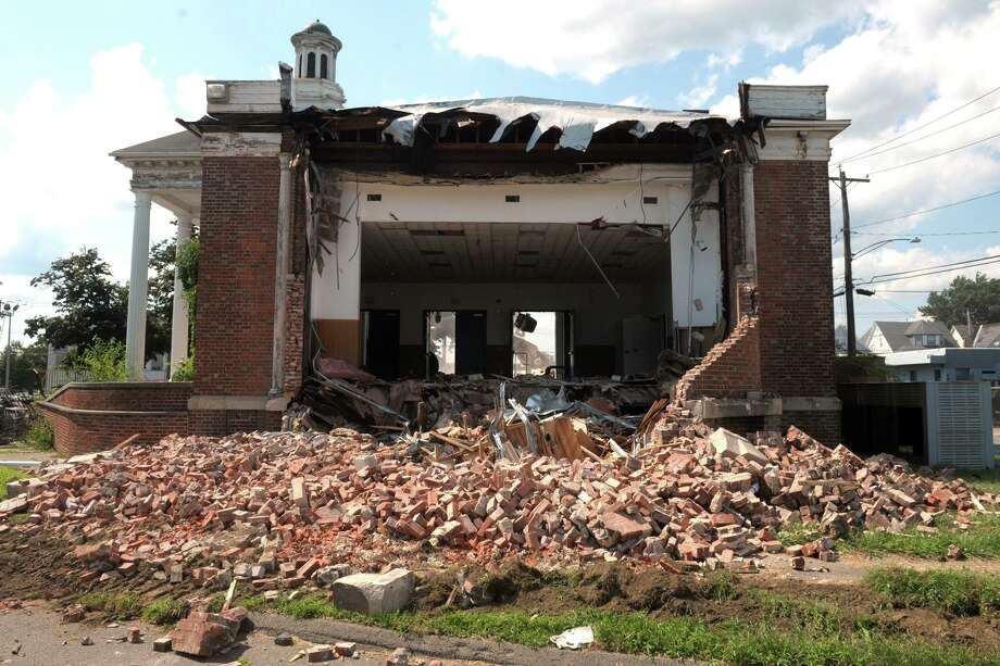 Demolition began Thursday on the former West End Branch Library building, also known as Sanborn Library, in Bridgeport, Conn. Aug. 1, 2019. The building, which was built in 1922 on the triangular property at the intersection of Fairfield Ave. and State St., has been vacant for many years, and has also served as a bank and community center. Photo: Ned Gerard / Hearst Connecticut Media / Connecticut Post