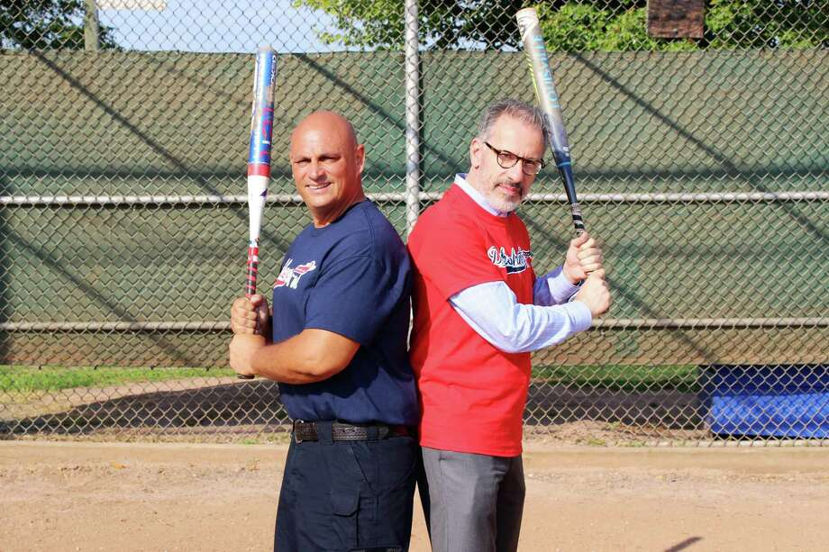 Norwalk Republican Town Committee Chairman Mark Suda, left. and Norwalk Democratic Town Committee Chairman Ed Camacho get ready for the inaugural charity softball game on Wednesday, July 31, 2019. Photo: Kelly Kultys / Hearst Connecticut Media /