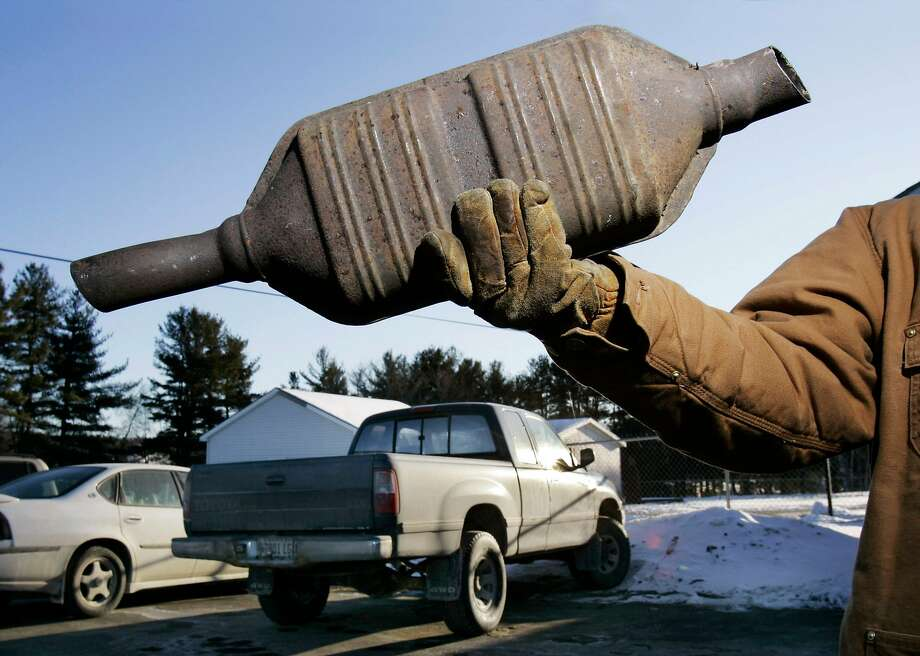 Catalytic converters can be removed from a car within a matter of minutes with a battery-powered saw. Photo: Robert F. Bukaty, AP