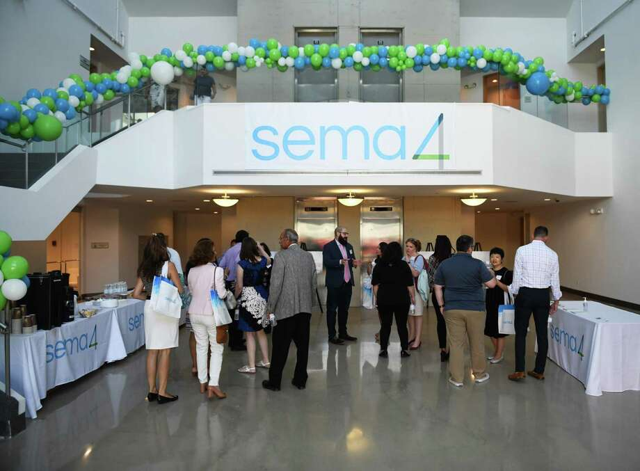 Attendees of the ground breaking tour genomic testing firm Sema4's lab site in the Waterside section of Stamford, Conn. Thursday, Aug. 1, 2019. Sema4 is a health intelligence company that uses advanced network analysis to build accurate models of individuals' health and deliver personalized insights for patients. U.S. Rep. Jim Himes and several local politicians attended the tour of the new Southfield Avenue facility and spoke of the importance of genomic testing and Sema4's mission. Photo: Tyler Sizemore / Hearst Connecticut Media / Greenwich Time