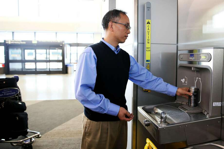Traveler Jiming Bao, of Houston, Texas, refills his water bottle at a hydration station in Terminal 3 at the San Francisco International Airport in San Francisco, Calif., on Thursday, August 1, 2019. The airport will require vendors to cease selling water in plastic bottles beginning August 20, replacing them with glass bottles or aluminum cans. Photo: Photos By Yalonda M. James / The Chronicle