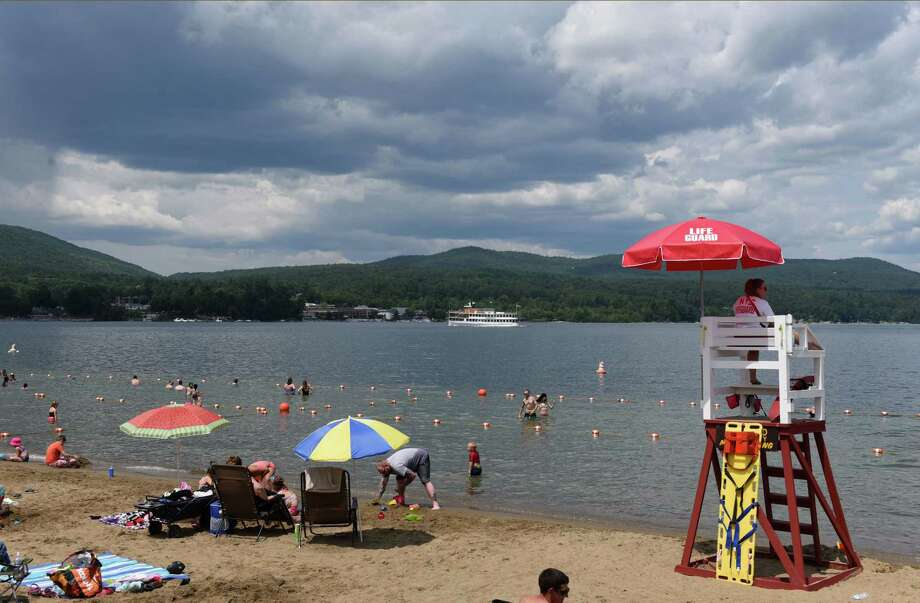 Bathers enjoy the waters of Lake George at Million Dollar Beach on Thursday, July 25, 2019, in Lake George, N.Y. (Will Waldron/Times Union) Photo: Will Waldron, Albany Times Union
