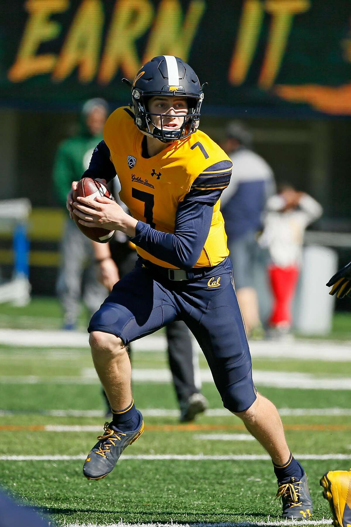 California Golden Bears quarterback Chase Garbers (7) keeps the ball on a read-option play during the annual Cal Spring Football Game at California Memorial Stadium on Saturday, March 16, 2019, in Berkeley, Calif.
