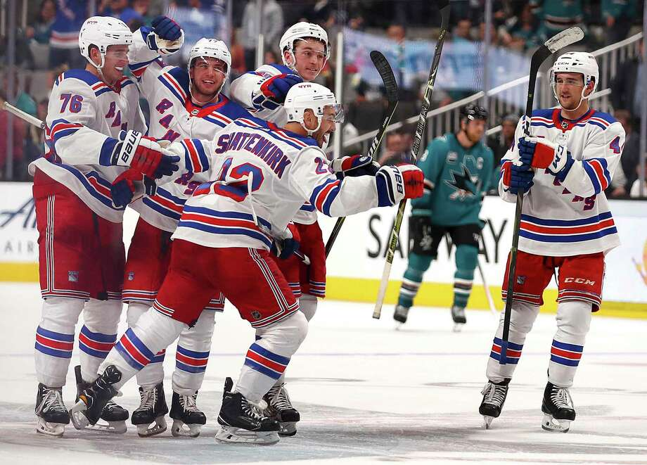The New York Rangers' Kevin Shattenkirk, center, is congratulated after scoring the game-winning shootout goal against the San Jose Sharks on Oct. 30 in San Jose, Calif. Photo: Ben Margot / Associated Press / Copyright 2018 The Associated Press. All rights reserved.