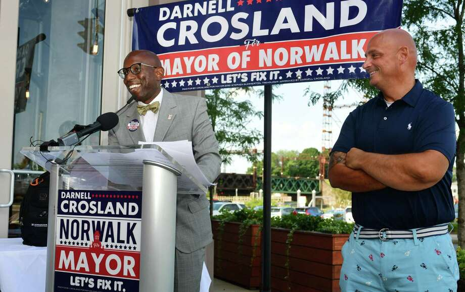 Mayoral candidate Darnell Crosland and Norwalk Republican Town Committee chairman Mark Suda announce the suspension of Crosland's campaign and his intention to run for Common Council as the RTC holds a news conference on Thursday at Washington Prime restaurant in Norwalk. Photo: Erik Trautmann / Hearst Connecticut Media / Norwalk Hour