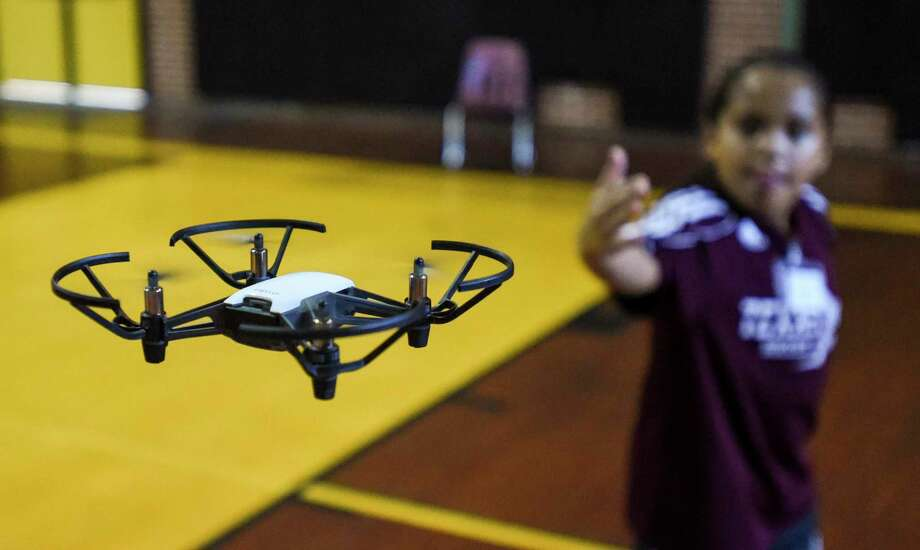 Ridge Syas, 10, helps direct a drone being flown by another student towards an obstacle during BISD's Drone Camp at the Early College High School Thursday.