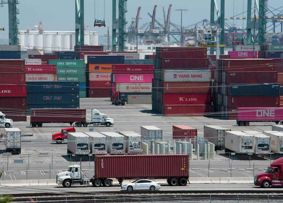 Shipping containers from China and Asia are unloaded at the Long Beach port, California on August 1, 2019. - President Donald Trump announced August 1 that he will hit China with punitive tariffs on another $300 billion in goods, escalating the trade war after accusing Beijing of reneging on more promises. (Photo by Mark RALSTON / AFP)MARK RALSTON/AFP/Getty Images Photo: MARK RALSTON, Contributor / AFP/Getty Images / AFP or licensors