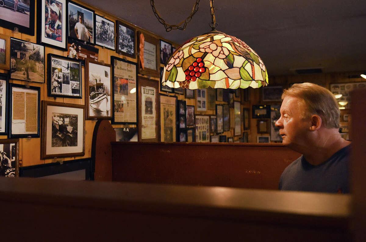 Tim Harrison surveys the historic walls of Canyon Inn in Emerald Hills.