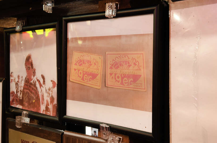 """Harrison had golden-hued cards printed for the entire organization that had """"Canyon Inn / 49ers / Winning Team"""" printed on them, along with each cardholder's name. Photo: Blair Heagerty / SFGate"""