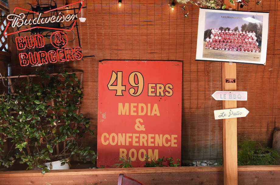 """The old """"49ers Media & Conference Room"""" sign that used to reside at Red Morton for Tuesday press conferences (which Harrison catered)? It's in Canyon Inn's back patio beer garden. Photo: Blair Heagerty / SFGate"""