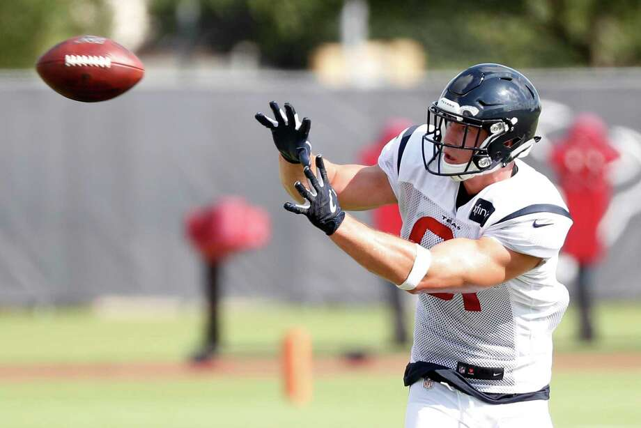 PHOTOS: Texans training camp  Houston Texans tight end Kahale Warring reaches back to make a catch during training camp at the Methodist Training Center on Thursday, Aug. 1, 2019, in Houston. >>>See photos from the Texans' training camp on Thursday, Aug. 22, 2019 ...  Photo: Brett Coomer, Houston Chronicle / Staff Photographer / © 2019 Houston Chronicle
