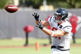 Houston Texans tight end Kahale Warring reaches back to make a catch during training camp at the Methodist Training Center on Thursday, Aug. 1, 2019, in Houston.