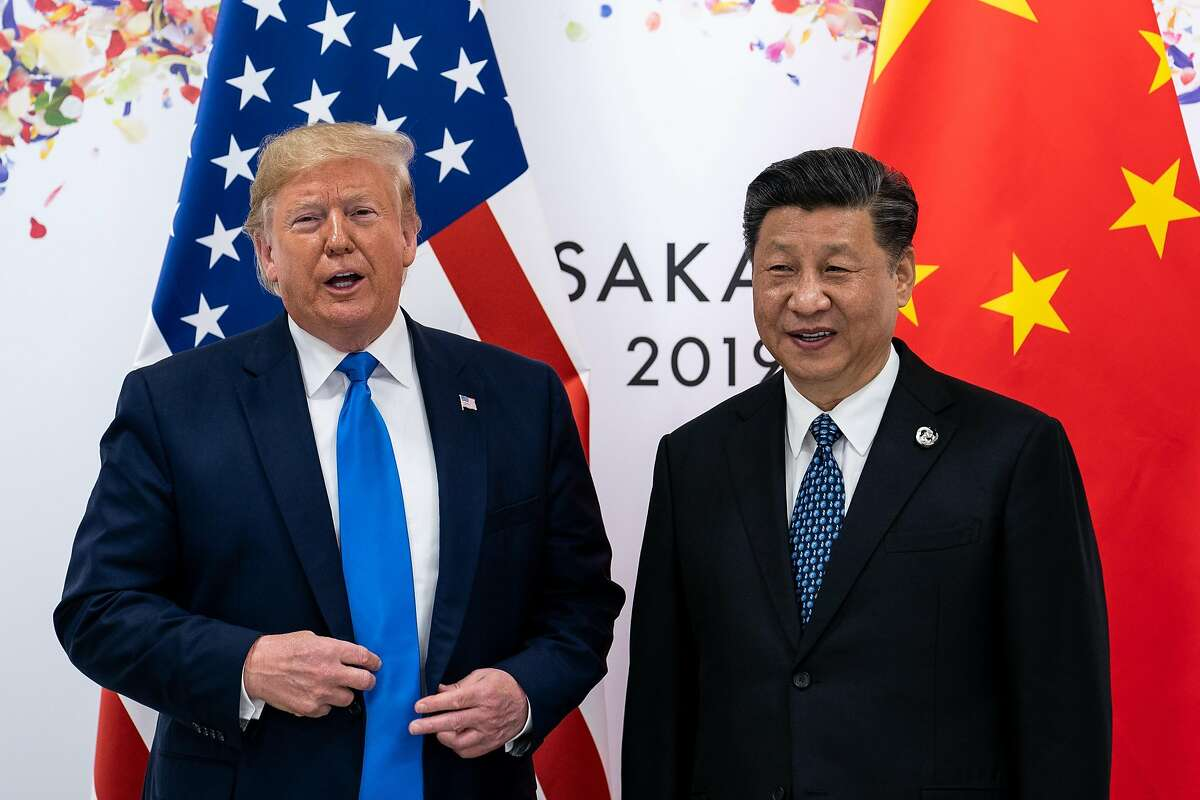 FILE-- President Donald Trump and President Xi Jinping of China at the G-20 Summit in Osaka, Japan, June 29, 2019. Trump, frustrated by increasingly fruitless negotiations with China, said on Aug. 1 that the U.S. would impose a 10 percent tariff on an additional $300 billion worth of Chinese imports next month, a significant escalation in a trade war that has dragged on for more than a year. (Erin Schaff/The New York Times)