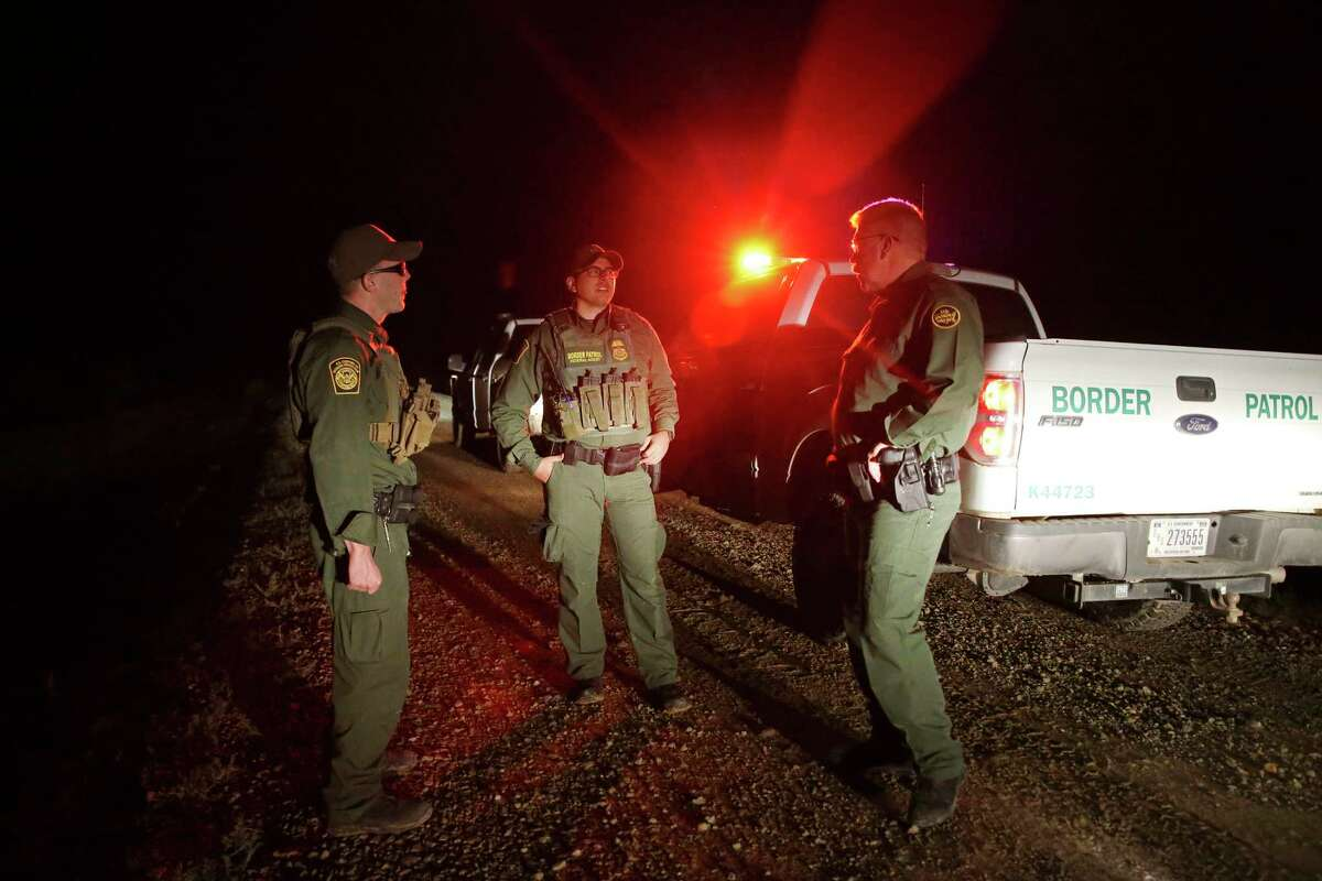 U.S. Border Patrol Agent in Charge Derek Boyle, right, talks with his agents after they apprehended five Honduran migrants in Presidio, Texas, Tuesday, June 4, 2019. According to U.S. Border Patrol numbers, illegal crossing of mostly Central American immigrants has increased this year in Big Bend Sector. The group included a mother with her six-month-old child and three unaccompanied minors.