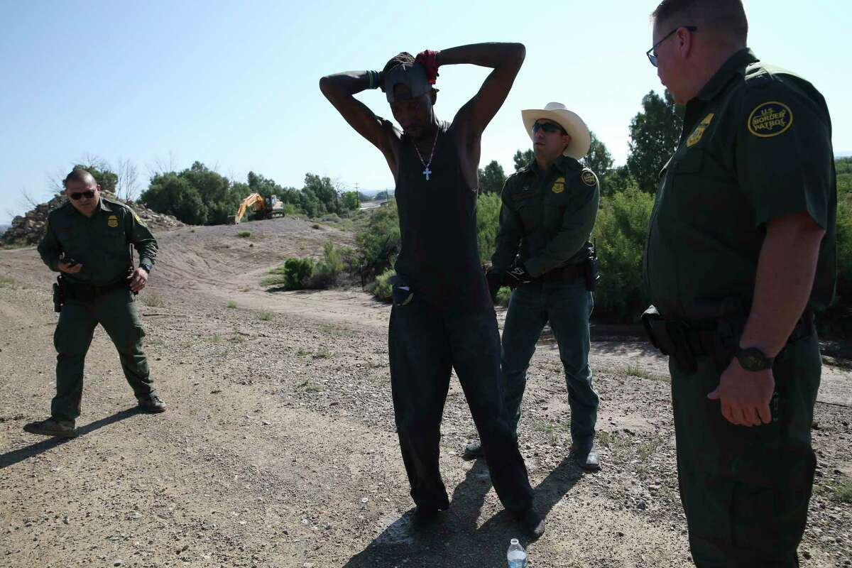 An Honduran migrant is detained after crossing the Rio Grande illegally in Presidio, Texas, Tuesday, June 4, 2019. According to U.S. Border Patrol numbers, illegal crossing of mostly Central American immigrants has increased this year in Big Bend Sector.