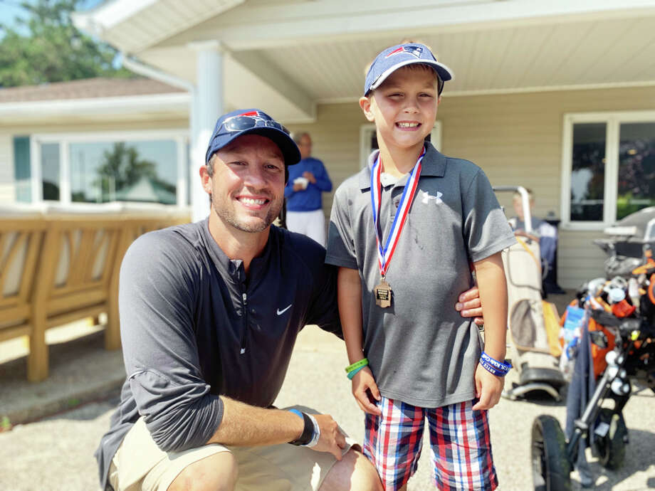 p.p1 {margin: 0.0px 0.0px 0.0px 0.0px; line-height: 10.8px; font: 10.0px Helvetica} Ric Moody, left, and his son, Bo Moody pose for a photo Thursday. Bo is a 7-year old golfer who regularly competes in the 10-12 age bracket in tournaments during the summer months. Thursday, Bo tallied a nine-hole score of 52, securing a third-place medal at the Buckley Junior Golf Tournament at Rolling Hills Golf Course in Cass City. (Eric Rutter/Huron Daily Tribune) Photo: Eric Rutter/Huron Daily Tribune