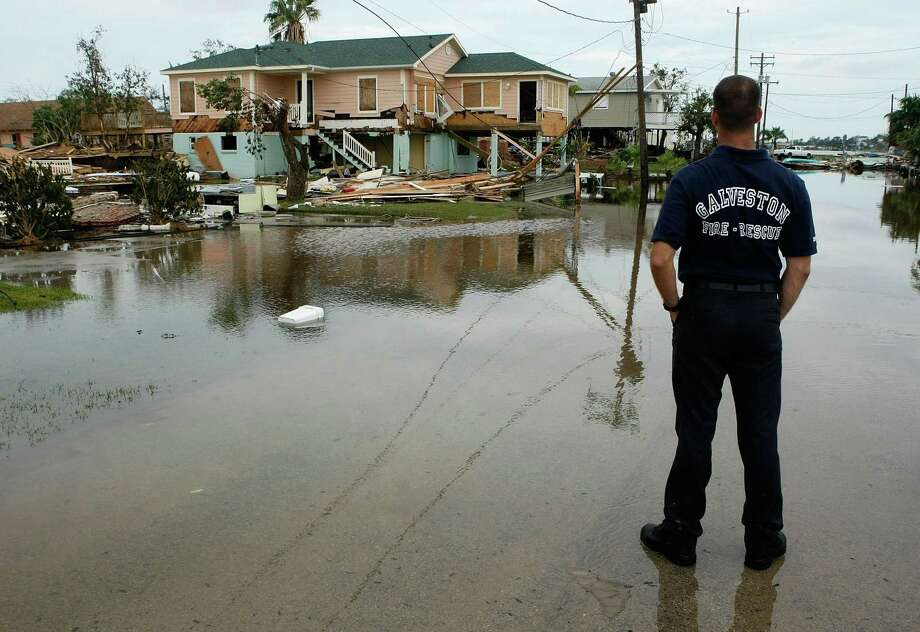 GALVESTON, TX - SEPTEMBER 14: Galveston fire fighter Jarod Hutson inspects damaged homes September 14, 2008 in Galveston, Texas. Hurricane Ike made landfall yesterday morning at Galveston causing widespread wind and flood damage along the Texas and Louisiana coasts. (Photo by Mark Wilson/Getty Images) Photo: Mark Wilson, Staff / Getty Images / Getty Images North America