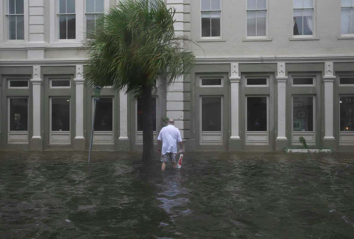 Dave Young makes his way in flood ward to get back to his resident in historical downtown Tuesday, Aug. 29, 2017, in Galveston. Galveston Island was under water after rain over night and some parts of town was higher than waist-deep. ( Yi-Chin Lee / Houston Chronicle )