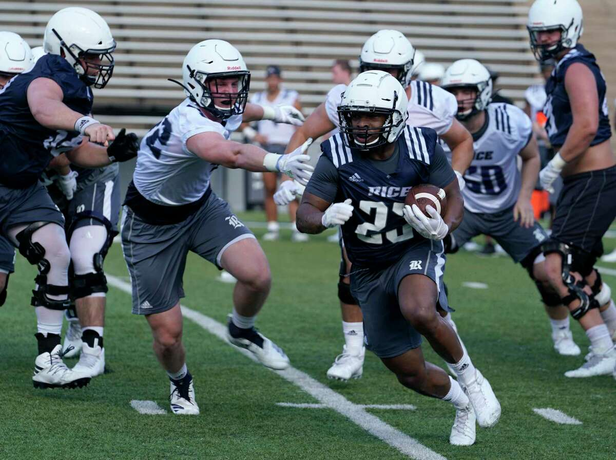 Rice player Charlie Booker carries the ball during football practice at Rice University Thursday, Aug. 1, 2019, in Houston.