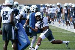 Rice player Treshawn Chamberlain (17) runs a drill during football practice at Rice University Thursday, Aug. 1, 2019, in Houston.