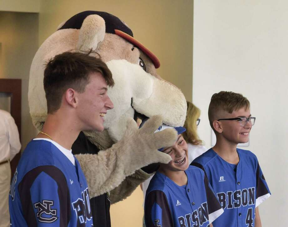 Members of the North Colonie Bison Blue 12u baseball team, Jake Iacobaccio, left, Lorenzo Lanni, center, and Ethan McGarry joke around with Tri-City ValleyCats mascot Southpaw at the Albany International Airport during a send off for members of the team on Wednesday, July 31, 2019, in Colonie, N.Y. The team was heading to Branson, MO to compete in the Cal Ripken World Series. Last summer the team brought home the Cal Ripken Mid-Atlantic Regional Tournament as eleven year olds and under. That earned them the spot to compete in the Cal Ripken World Series this summer.     (Paul Buckowski/Times Union) Photo: Paul Buckowski / (Paul Buckowski/Times Union)