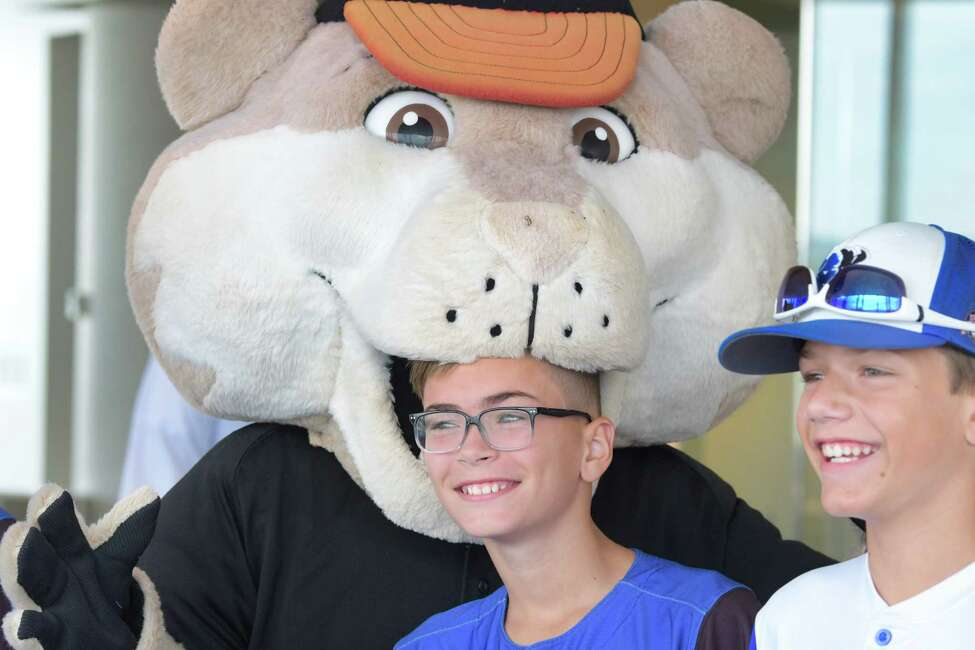 Members of the North Colonie Bison Blue 12u baseball team, Ethan McGarry, left, and Tye Mariano, right, joke around with Tri-City ValleyCats mascot Southpaw at the Albany International Airport during a send off for members of the team on Wednesday, July 31, 2019, in Colonie, N.Y. The team was heading to Branson, MO to compete in the Cal Ripken World Series. Last summer the team brought home the Cal Ripken Mid-Atlantic Regional Tournament as eleven year olds and under. That earned them the spot to compete in the Cal Ripken World Series this summer. (Paul Buckowski/Times Union)