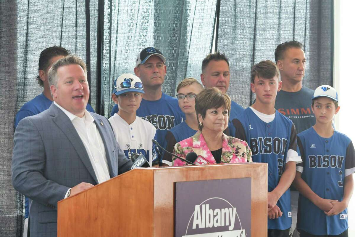 Albany County Executive Daniel McCoy, at podium, and Colonie Town Supervisor Paula Mahan, foreground right, along with players and coaches from the North Colonie Bison Blue 12u baseball team, take part in a send off for members of the team at the Albany International Airport on Wednesday, July 31, 2019, in Colonie, N.Y. The team was heading to Branson, MO to compete in the Cal Ripken World Series. Last summer the team brought home the Cal Ripken Mid-Atlantic Regional Tournament as eleven year olds and under. That earned them the spot to compete in the Cal Ripken World Series this summer. (Paul Buckowski/Times Union)