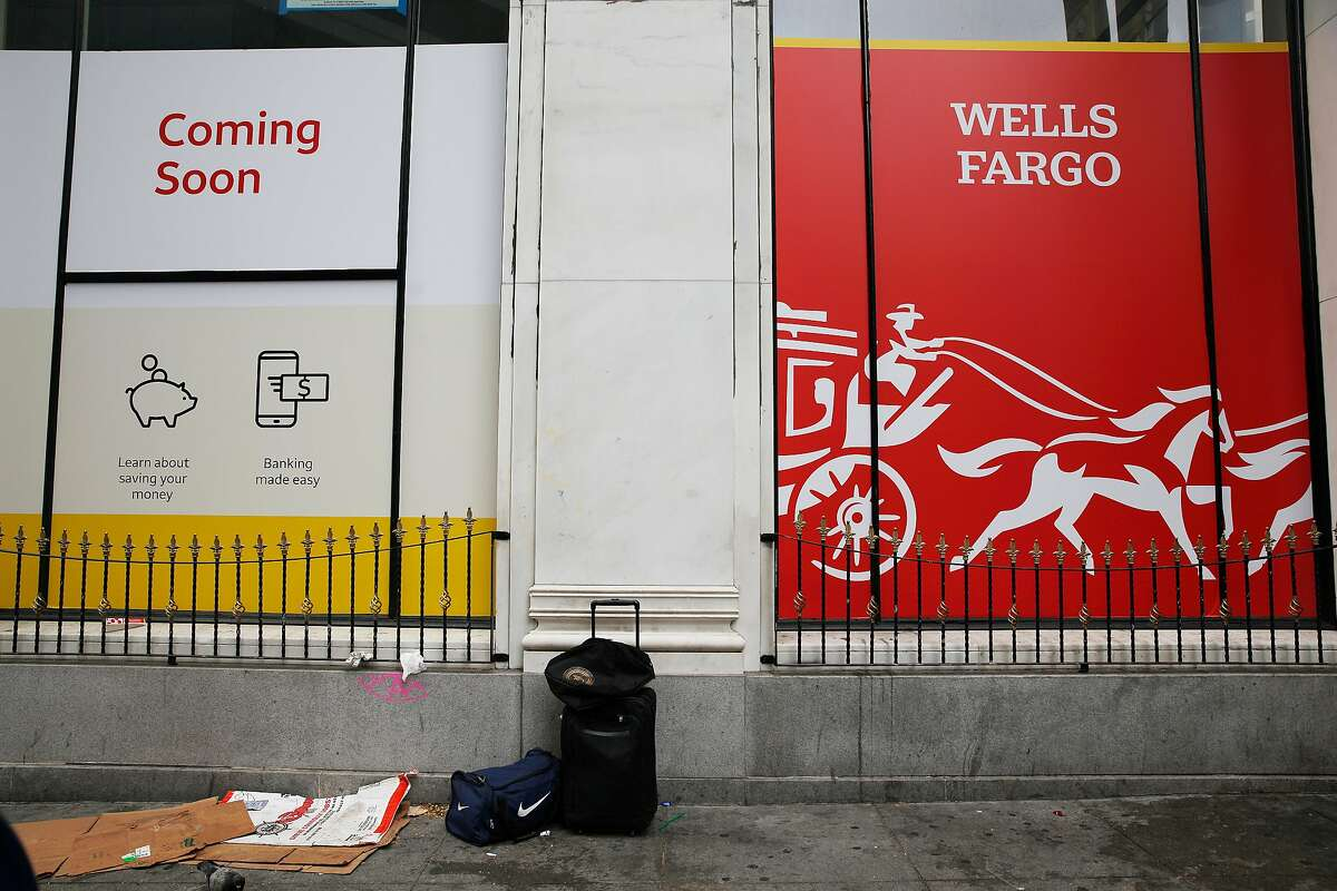 Signs announcing that Wells Fargo bank is coming soon are seen at 601 Market Street on Tuesday, July 30, 2019 in San Francisco, Calif.